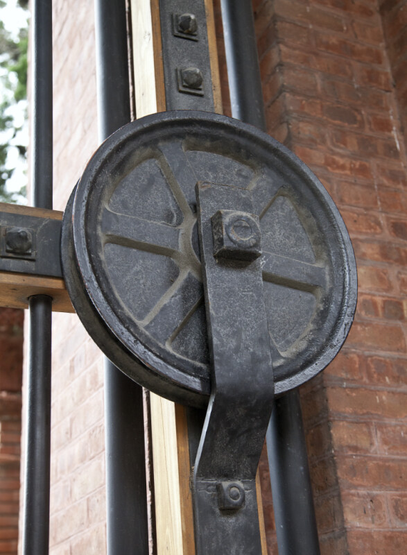 A Metal Sheave Used to Open a Gate