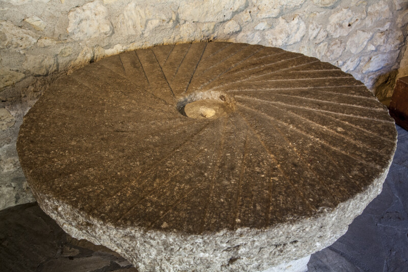 A Millstone in the Alamo Main Building