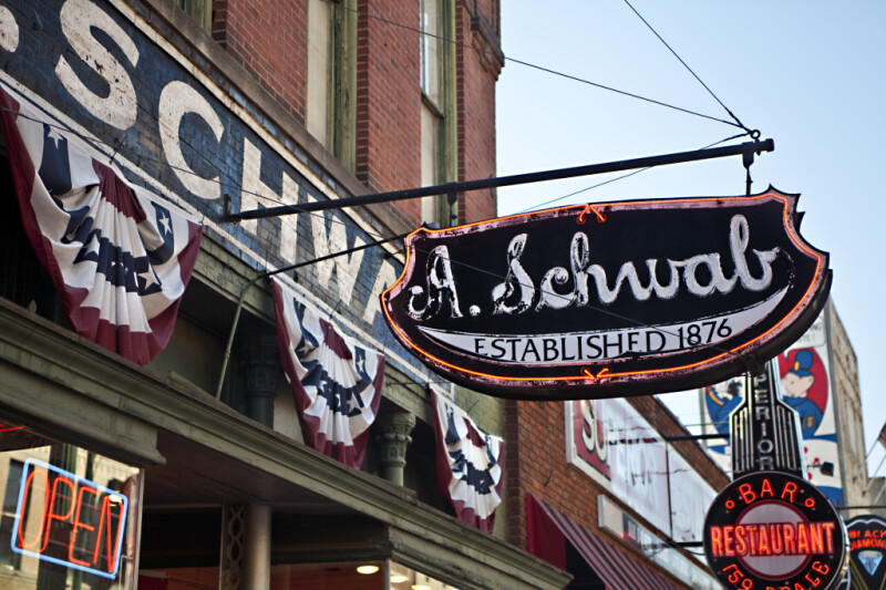 A Neon Sign Outside A. Schwab's Store