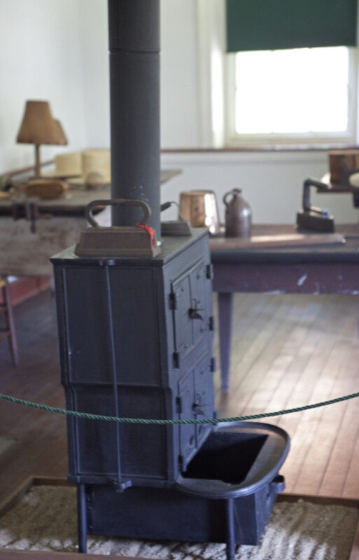 A Pair of Flat Irons on the Old Cast Iron Stove