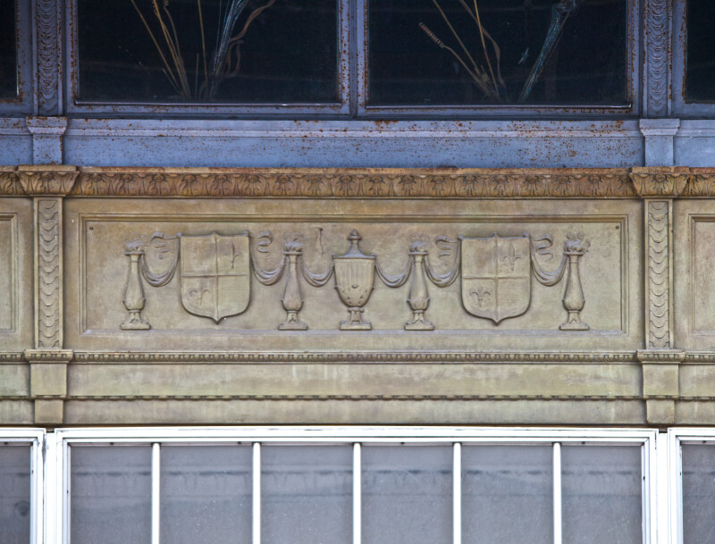 A Panel with Urns and Escutcheons in Relief