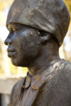 A Profile View of the Left Side of the Face of a Bronze Sculpture