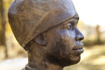 A Profile View of the Right Side of the Face of a Bronze Sculpture