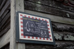 A Promotional Sign for the Oldest Wooden Schoolhouse