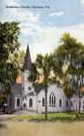 A Quaint Methodist Church With Gothic Stained-Glass Windows