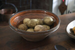 A Redware Bowl with Potatoes
