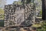 A Rough Stone Building with a Wooden Door