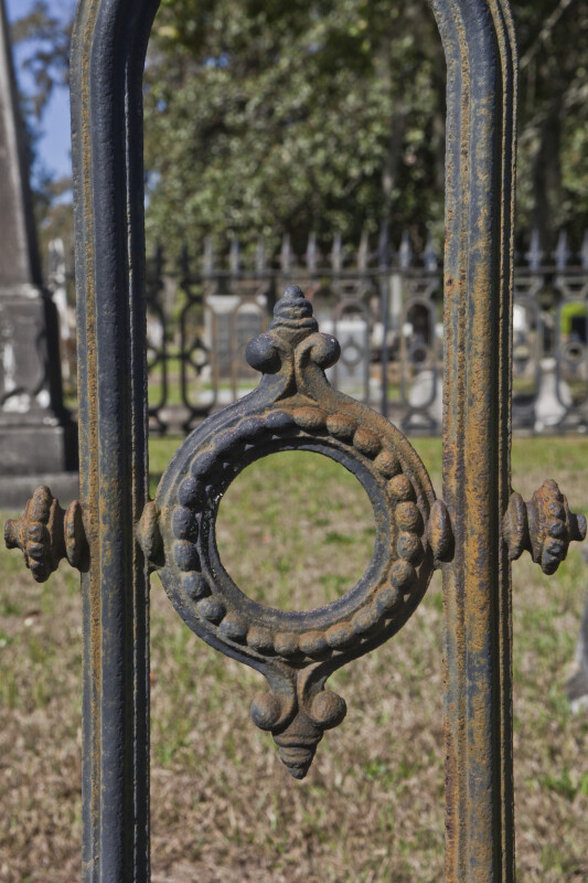 A Round Element in a Cemetery Fence