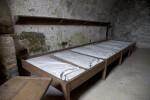 A Row of Wood-Framed Bunks