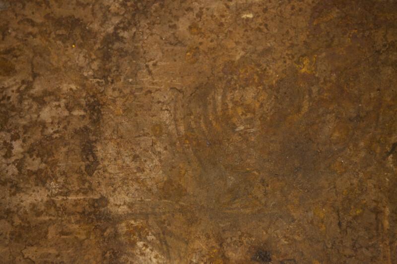 A rust colored surface.