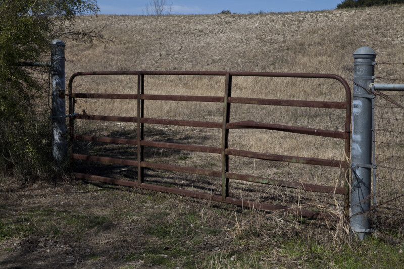 A Rusty Fence Gate Near Espada Acequia