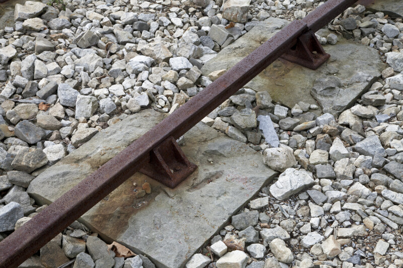 A Rusty Rail Secured in Stone Sleepers