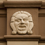 A Sculpted Face, with a Diadem, on a Building