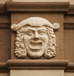 A Sculpted Face, with a Hat, on a Building