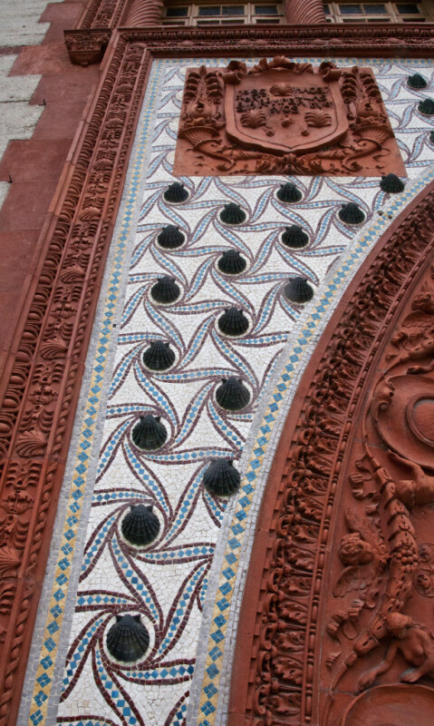 A Shell Mosaic and a Terracotta Escutcheon