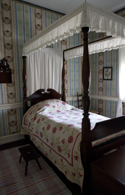 A Short Bench by a Four-Poster Bed