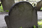 A Shouldered Tablet Headstone with a Death's Head Carving