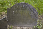 A Shouldered Tablet Headstone with A Death's Head Motif