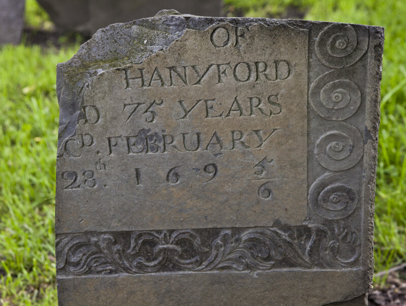 A Shouldered Tablet Headstone with Vertical and Horizontal Breaks