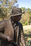 A Side View of a Bronze Sculpture Depicting a Farmer