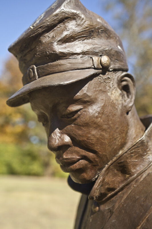 A Side View of the Face of a Bronze Sculpture Depicting a Soldier