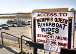 A Sign Advertising the Location of a Business That Provides Riverboat Rides