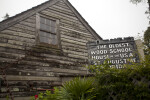 A Sign outside the Oldest Wooden Schoolhouse