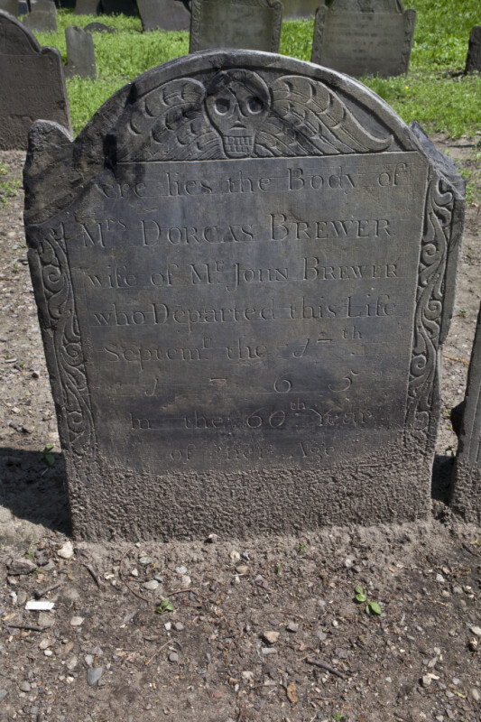A Slate Headstone with A Death's Head Carving