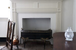 A Solid Fireplace Screen on Tall Legs