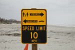 A Speed Limit Sign on a Beach