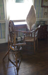 A Spinning Wheel by a Window