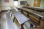 A Standing Desk for the Teacher, and Benches for the Students