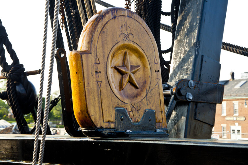 A Star Carved into a Piece of Wood