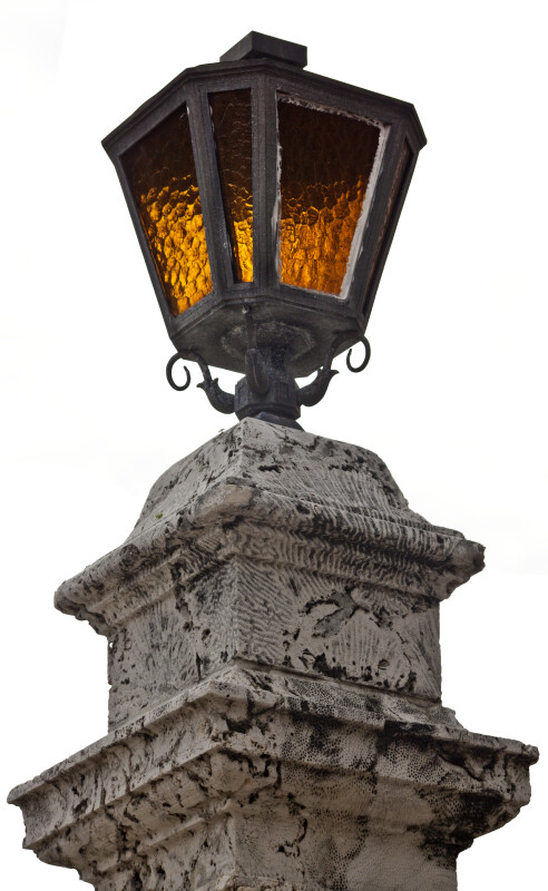 A Street Lamp on a Concrete Pillar