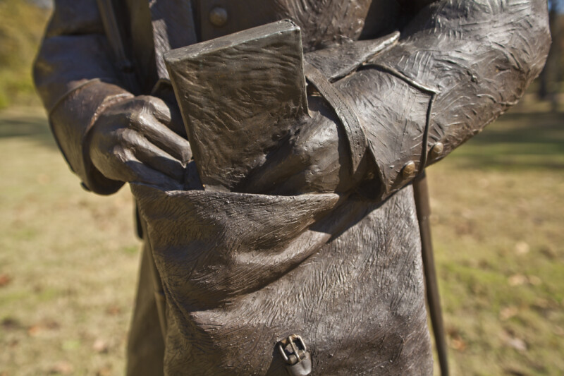A View of a Soldier Retrieving a Book from His Pouch