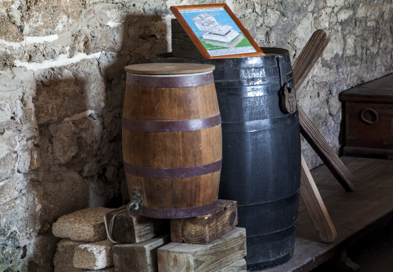 A Vignette of a Spigoted Keg and a Secured Storage Barrel