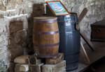 A Vignette of a Spigoted Keg and a Secured Storage Barrel