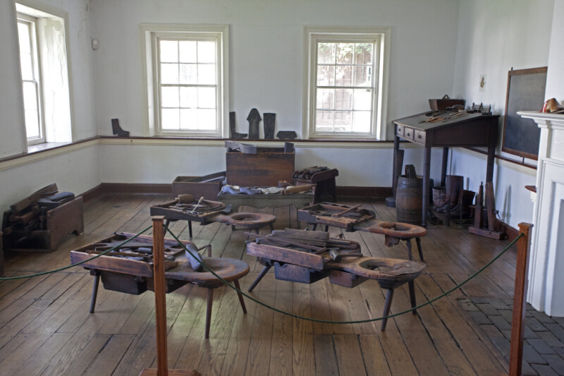 A Wide View of the Shoemaker's Workshop