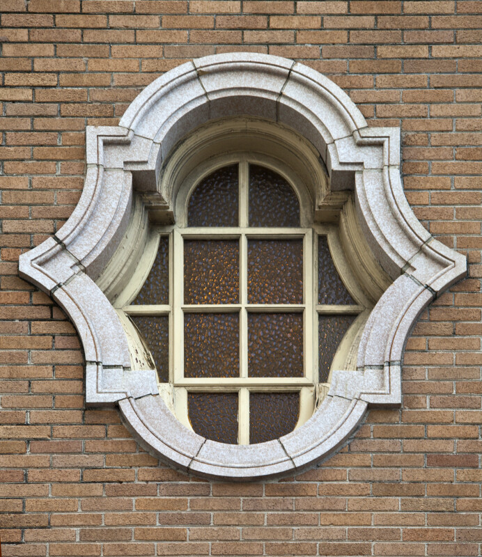 A Window with a Heavy Stone Frame