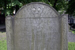 A Winged Death's Head on a Headstone