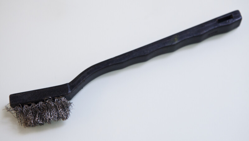A wire brush.