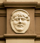 A Woman's Sculpted Face, with a French Hood, on a Building