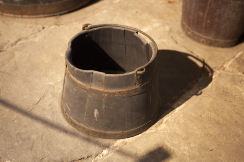 A Wooden Bucket in the Wine Cellar