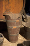 A Wooden Bucket with A Large Notch in the Lip