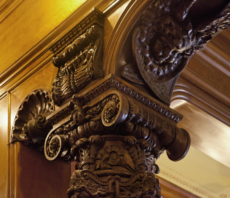 A Wooden Column with Volutes on the Capital