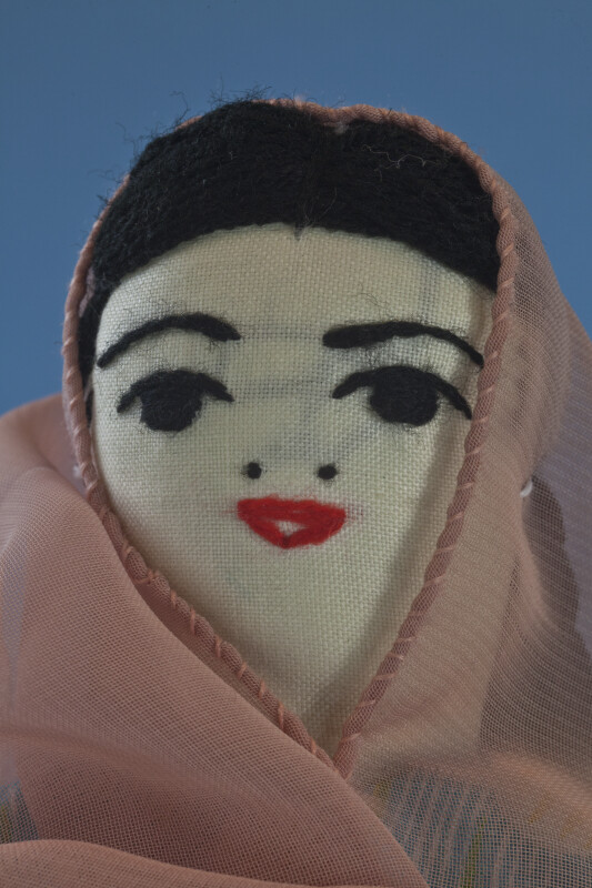 Afghanistan Hand Made Fabric Lady Wearing a Head Scarf (Close Up)