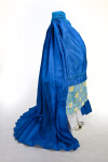 Afghanistan Woman Wearing Blue Silk Burqa Over Pajami (Side View)