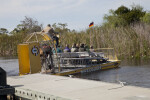 Airboat Full of Passengers Leaving a Dock