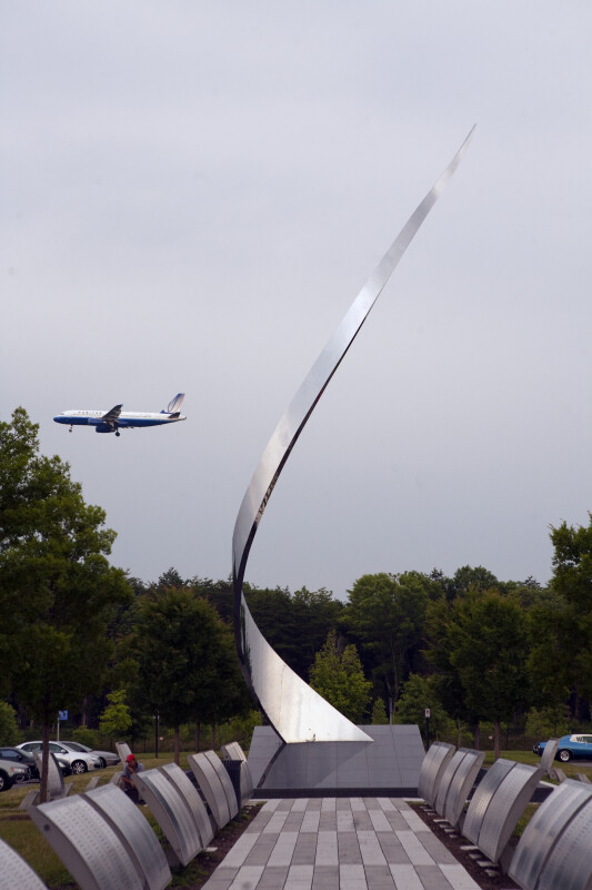 "Airplane and ""Ascent"" Sculpture"