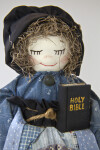 Alabama Female Doll with Embroidered Face and Bonnet Holding the Holy Bible (Close Up)